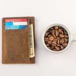 wallet with cash cards, and coffee beans